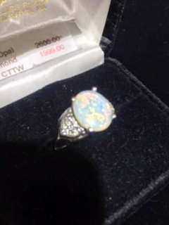 Fine opal and diamond ring