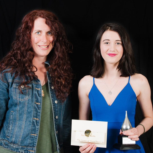 Lily with her Buddy Award and presenter