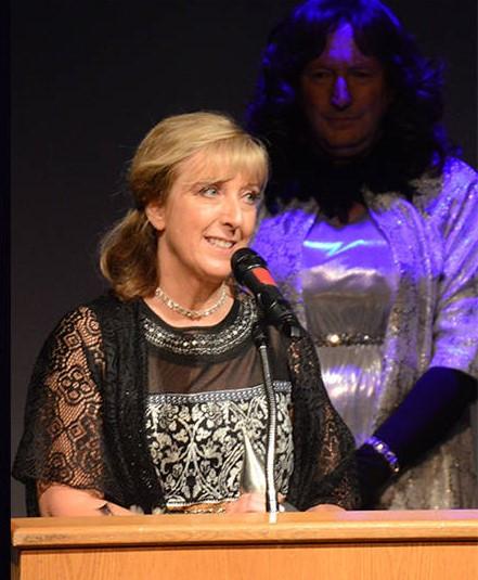 Michelle McCue, Award Winner (Bob McCue in background)