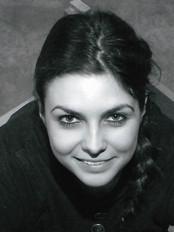Caroline Murray as Ellie