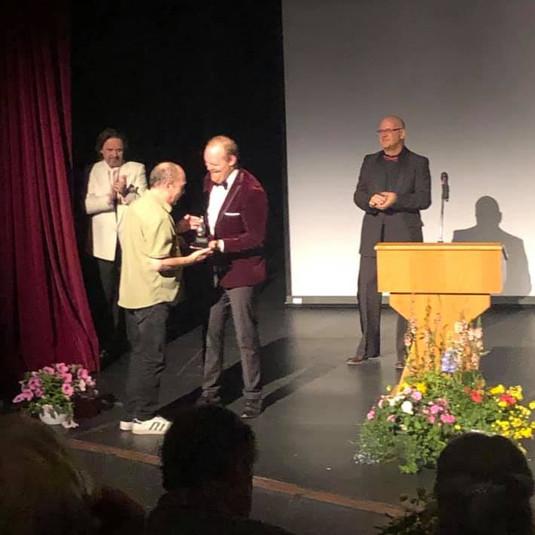 Jim receiving Buddy Award