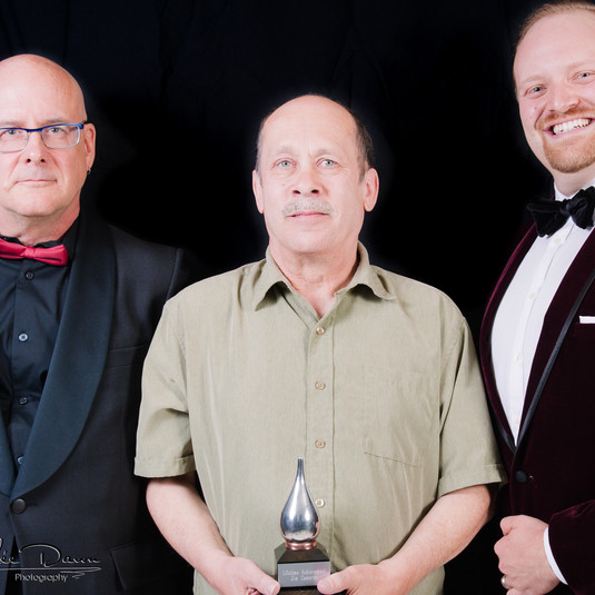 Jim with his Buddy Award and presenters