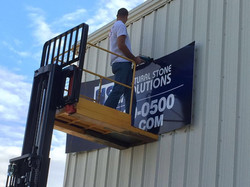 Outdoor sign being installed
