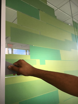 Clear film being installed on Glass