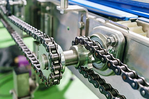 Gear and chain drive shaft in conveyor c
