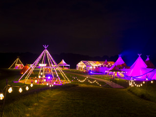 How good do the tipis and marquee look at night!