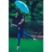 Woman Jumping with Umbrella Netra Narang