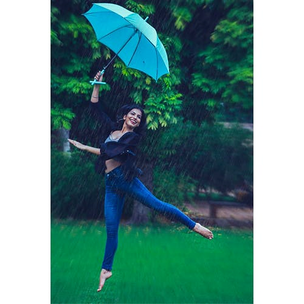 Woman Jumping with Umbrella Netra Narang