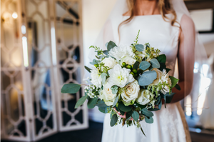 Incorporating lots of foliage in wedding flower arrangements makes a real statement