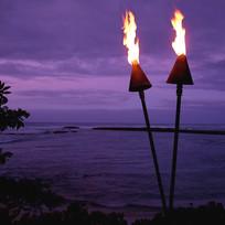 tiki-torches-in-hawaii-at-sunset-skodonn