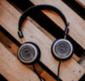 gray and black corded headphones on top of brown wooden surface_edited.jpg