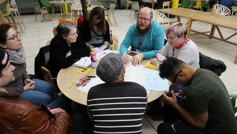 A group convenes at Collaboration Station