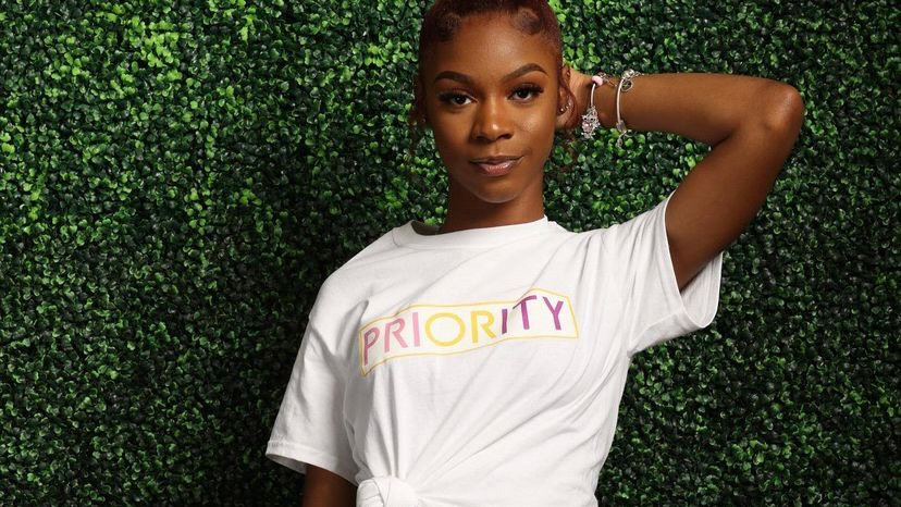 PRIORITY T-Shirt : White w  Pink , Purple and Yellow words