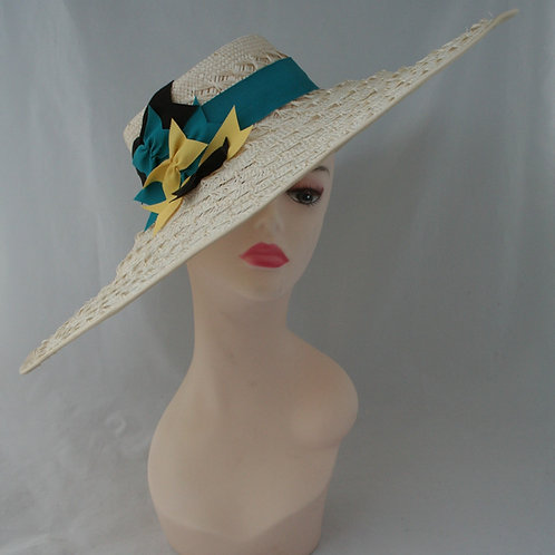 Textured wide brim straw hat with bow detail
