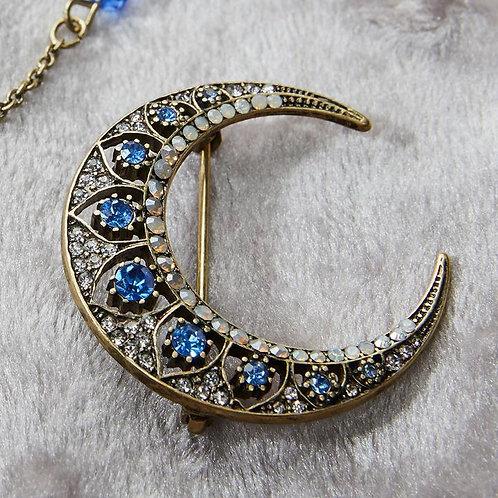Crescent moon brooch