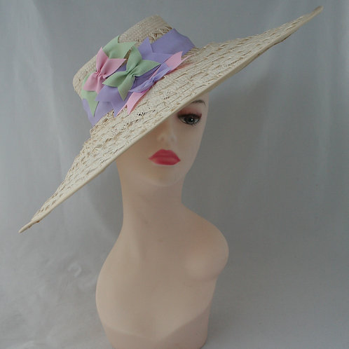 Textured wide brim straw hat with bow detail