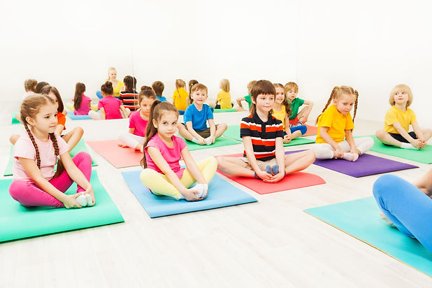 Kids doing butterfly exercise sitting on