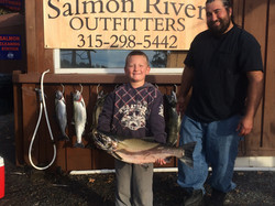 Kid with Salmon, Trout and Steelhead
