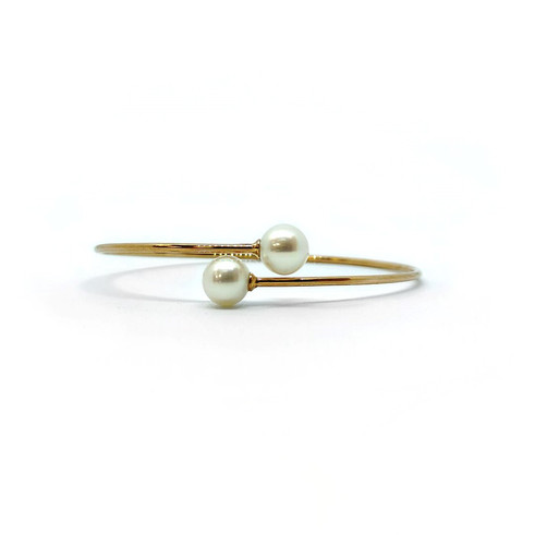 yellow gold pearl bangle.jpg