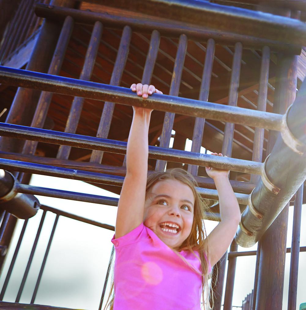happy child on monkey bars