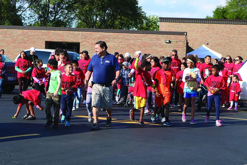 Mayor Pineda walking with students outside school