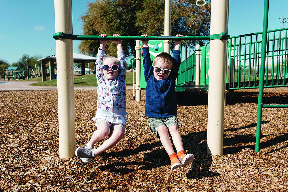 Kids playing on a playground outside