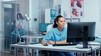 nurse-working-on-pc-H5J2CLE.jpg