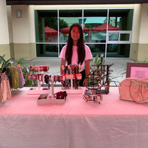 selling bags and accessories at childrens business fair