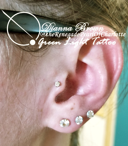 Tragus with champagne stone