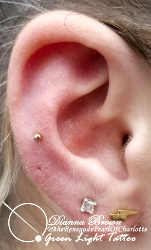 Mid-range Helix Piercing with a 14kt Yellow Gold 2.5mm Ball