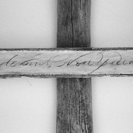 Calico on driftwood cross (close-up) 64cm x 89cm Inscription reads_ Qui dormit non peccat (he who sleeps does not sin) #bedroomdecor #bnw