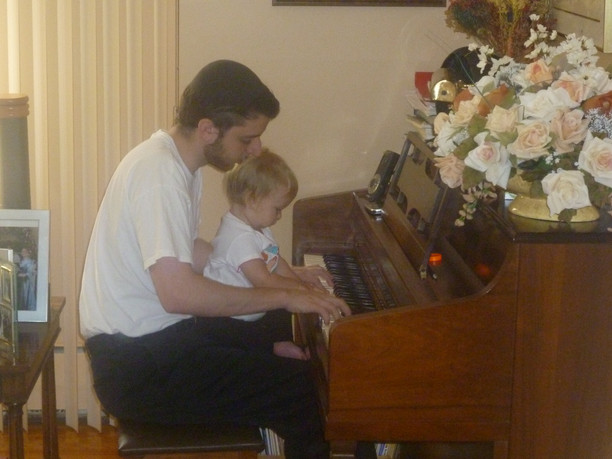Playing piano with our niece