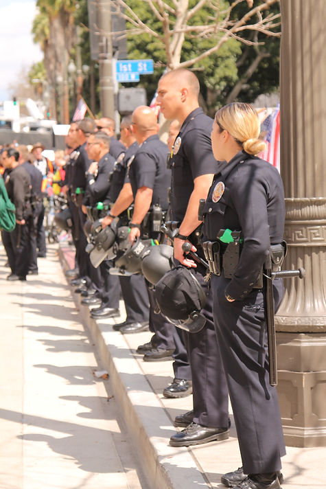Los Angeles Police officers are protecting gun protesters against Trump supporters.
