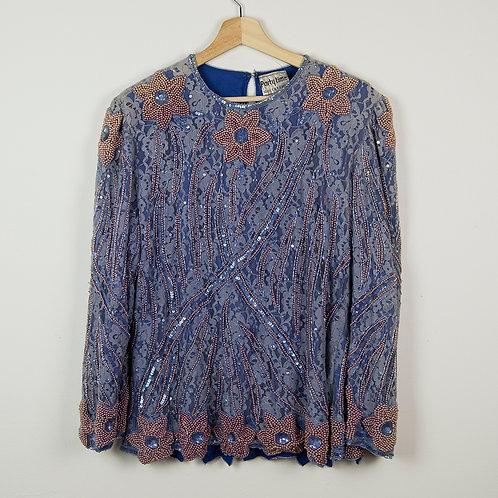 Blusa azul con pedrería. Talla L