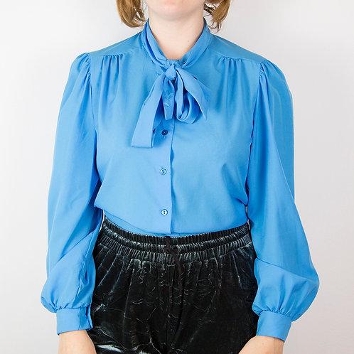 Blusa azul con lazo. Talla M