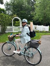 Riding my electric bike.