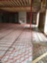 Residential basement floor warming tube