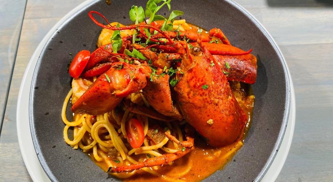 Spaghetti de Langosta in a fiery Arrabiata sauce