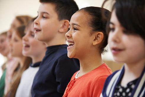 Group Of School Children Singing In Choir Together.jpg