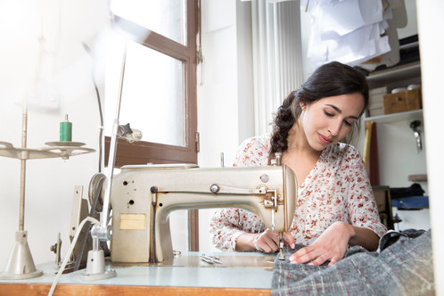 Seamstresswithsewingmachine-GettyImages-