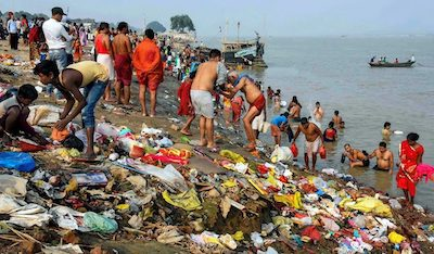 People spreading waste around river banks