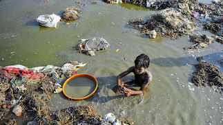 Child bathing in polluted river