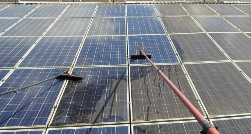 Solar panels being cleaned