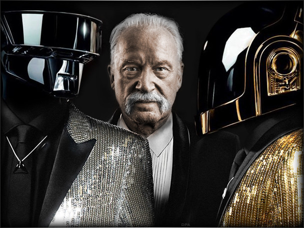 Giorgio Moroder standing between Daft Punk