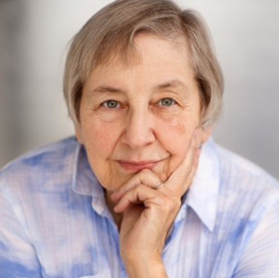 Penny Simkin, rested her chin in her hand in thoughtful manner, looking directly at us with piercing blue eyes