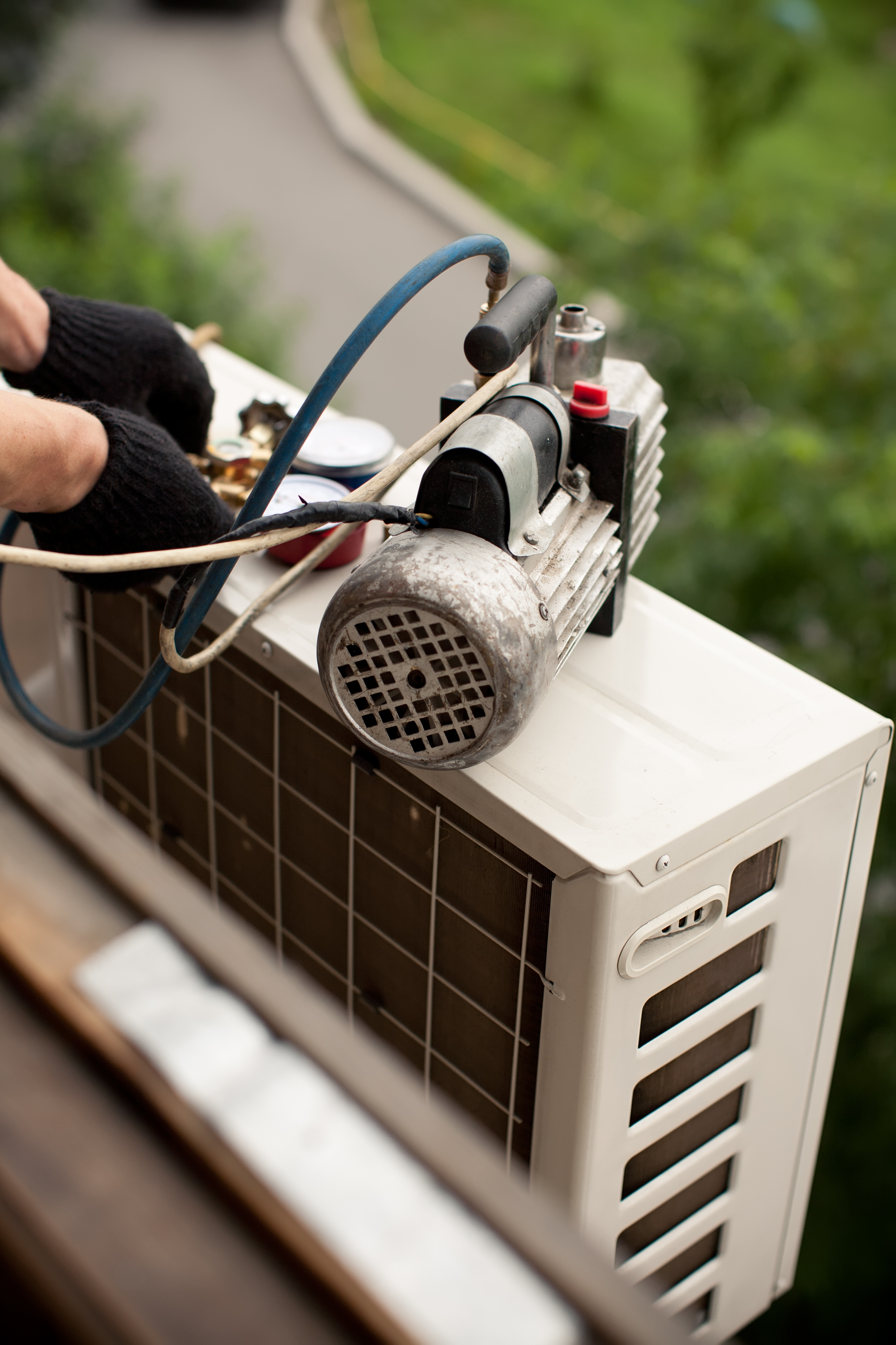 Air conditioning master preparing to install new air conditioner