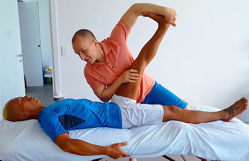 Practitioner assisted hamstring and calf stretch at Miami Stretch Therapy