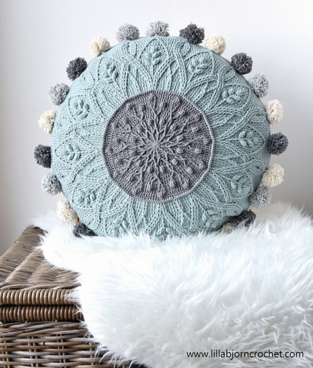 Sakura Cabled Mandala Pillow by Tatsiana Kupryianchyk