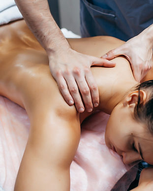 Physiotherapist giving neck massage to a