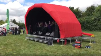 Red cotton stage for hire - JAM Stage Hire